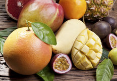 Exotic fruits on a wooden table. Stock Image