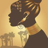 Exotic girl. Stylized black woman silhouette on golden background Royalty Free Stock Photos