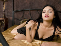 Exotic Girl in Bed Stock Image