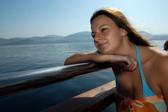 Exotic girl model posing on boat. Attractive charming exotic girl enjoying boat travel, close up stock images
