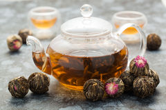 Exotic green tea glass teapot Royalty Free Stock Images