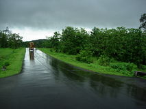 Exotic Highway Scene. Empty and wet Road in Monsoon Stock Photo