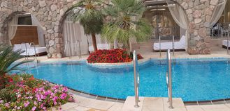 Exotic hotel rooms with swimming pool entrance royalty free stock images