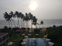 Exotic hotel with swimming pool and palms on the beach of ocean, Sri Lanka, beach stock photo