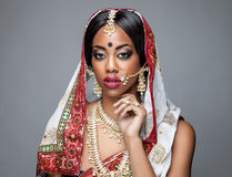 Exotic Indian bride dressed up for wedding. Ceremony Royalty Free Stock Image