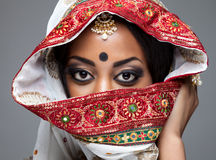 Exotic Indian bride dressed up for wedding. Ceremony Stock Photo