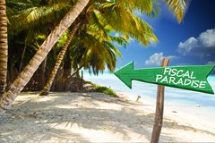 Exotic island without taxes, green arrow indicating fiscal paradise. Sea or ocean in the background Stock Photos