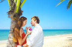 Exotic journey. A portrait of attractive couple having date on the beach Stock Photos