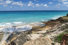Exotic landscape. Ocean hitting on the rock beach of Varadero, Cuba on a warm april day Stock Images