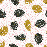 Exotic leaves and dots ornament. Seamless hand drawn tropical  pattern. Vector background. Exotic leaves and dots ornament. Seamless hand drawn tropical Royalty Free Stock Photos
