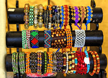 Exotic and loom bracelets on a stand Royalty Free Stock Image