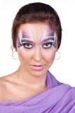 Exotic makeup. Portrait of a beautiful woman with an exotic makeup Royalty Free Stock Photos
