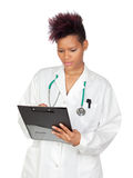 Exotic medical girl with clipboard Stock Photography