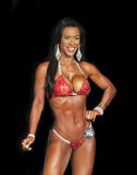 Exotic Middle-Aged Bikini Beauty. Exotic, enchanting beauty, Maya Kekahuna, poses at the 2016 NPC Universe finals in Teaneck, New Jersey, on July 2, 2016.  She Stock Images