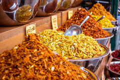 Exotic middle east spices mounds offered for sale on Mahane Yehu Royalty Free Stock Image