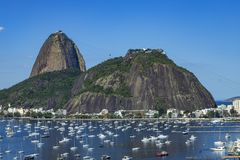 Exotic mountains. Famous mountains. Mountain of the Sugar Loaf in Rio de Janeiro, Brazil South America. Panoramic view of boats and yachts in the marina royalty free stock photos