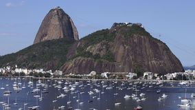 Exotic mountains. Famous mountains. Mountain of the Sugar Loaf in Rio de Janeiro, Brazil South America. Panoramic view of boats and yachts in the marina stock video footage