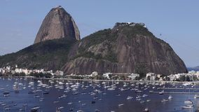 Exotic mountains. Famous mountains. Mountain of the Sugar Loaf in Rio de Janeiro, Brazil South America. Panoramic view of boats and yachts in the marina stock video
