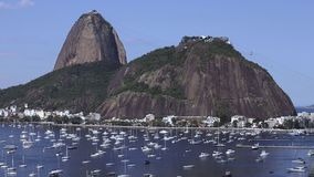 Exotic mountains. Famous mountains. Mountain of the sugar loaf in Rio De Janeiro, Brazil South America. Panoramic view of boats and yachts in the marina stock footage