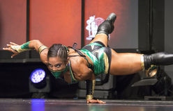 Exotic, Mysterious, and Flexible Female Athlete. Masked beauty Ariel Khadr of Miami, Florida, begins her stage routine at the 2016 IFBB  Toronto Pro Supershow in Stock Images