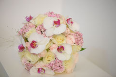 Exotic orchids, pale yellow and pink roses bridal bouquet Royalty Free Stock Images