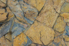 Exotic pattern of decorate slate stone wall background. Abstract Royalty Free Stock Image