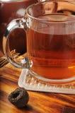 Exotic Pu-erh Tea. Hot Pu-erh tea with a pressed nest of the tea leaves Stock Photos