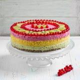Exotic raw vegan cake. Decorated with fresh fruits royalty free stock image