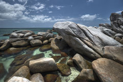 Exotic rocky beach at belitung island Royalty Free Stock Image