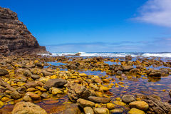 Exotic rocky beach in South Africa Stock Images