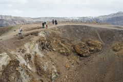 Exotic rocky road to the crater of the volcano. The volcano is located in the famous Caldera of Santorini. Stock Image
