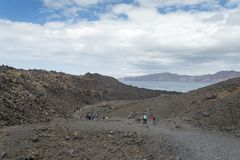 Exotic rocky road to the crater of the volcano. The volcano is located in the famous Caldera of Santorini. Stock Photos