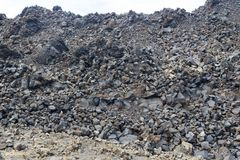 Exotic rocky road to the crater of the volcano. The volcano is located in the famous Caldera of Santorini. On a Sunny day Royalty Free Stock Photos