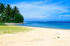 Exotic sandy beach view during sunny hot day in Polynesia, Manase beach fales stock photo