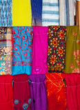 Exotic Scarves. A display of various brightly coloured shawls and scarves in a Dubai souk Stock Image