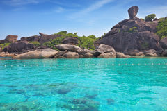 Exotic Similan Islands. Warm and clear azure ocean waters. At the bottom of the bay are visible coral Stock Photos