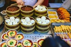 Exotic snacks and desserts , Beijing, China. Exotic snacks and desserts can be found in this famous market Donghuamen Night food market near Wangfujing street stock image
