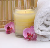 Exotic Spa. Pretty spa with exotic orchid blossom and towel with relaxing candel Stock Images