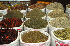 Exotic spices. Bags full of exotic spices on a green market Dubai, United Arab Emirates royalty free stock image