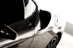 Exotic Sports Car Fender. A black and white image of an exotic sports car's rear fender and wheel Stock Images