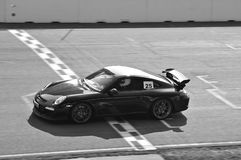 Sportscar crossing Finish Line of Racetrack Royalty Free Stock Photography