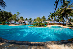 Exotic swimming pool near the beach. Photo of a beautiful tropical swimming pool near the beach Royalty Free Stock Image