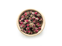 Exotic tea, roses buds in rustic bowl, topview Royalty Free Stock Photo