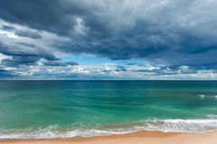 Exotic tropical beach, golden sand and beautiful clouds Stock Photo