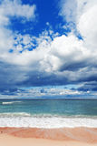Exotic tropical beach, golden sand and beautiful clouds Royalty Free Stock Photo