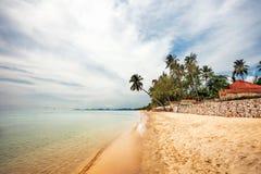 Exotic tropical beach under gloomy sky Stock Photo