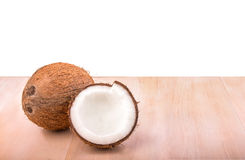 Exotic and tropical coconut, isolated on a white background. Healthy fruit. Hawaiian coconuts. A tasty whole and cut coconuts. Royalty Free Stock Photography
