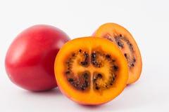 Exotic tropical fruit called tree tomato Solanum Betaceum. On white background Stock Image