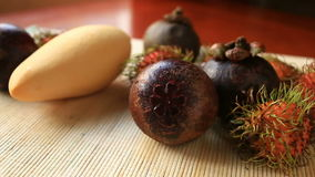 Exotic tropical fruit on table. Thai fruit. Exotic tropical fruit on table stock footage