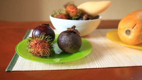 Exotic tropical fruit on table. Thai fruit. Exotic tropical fruit on table stock video